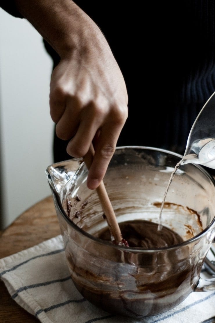 Mixing boiling hot water into chocolate cake batter