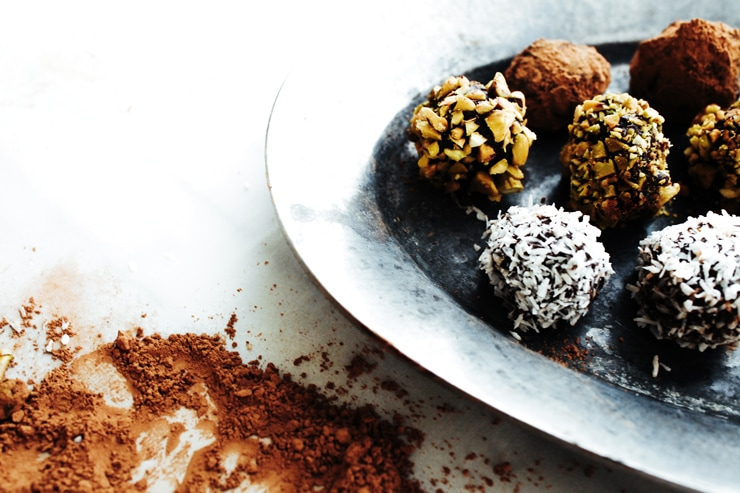 An easy recipe for melt-in-your-mouth, Chocolate Truffles made with luscious dark chocolate and amaretto liqueur. | sophisticatedgourmet.com