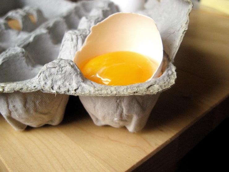 Broken egg in carton - Sophisticated Gourmet