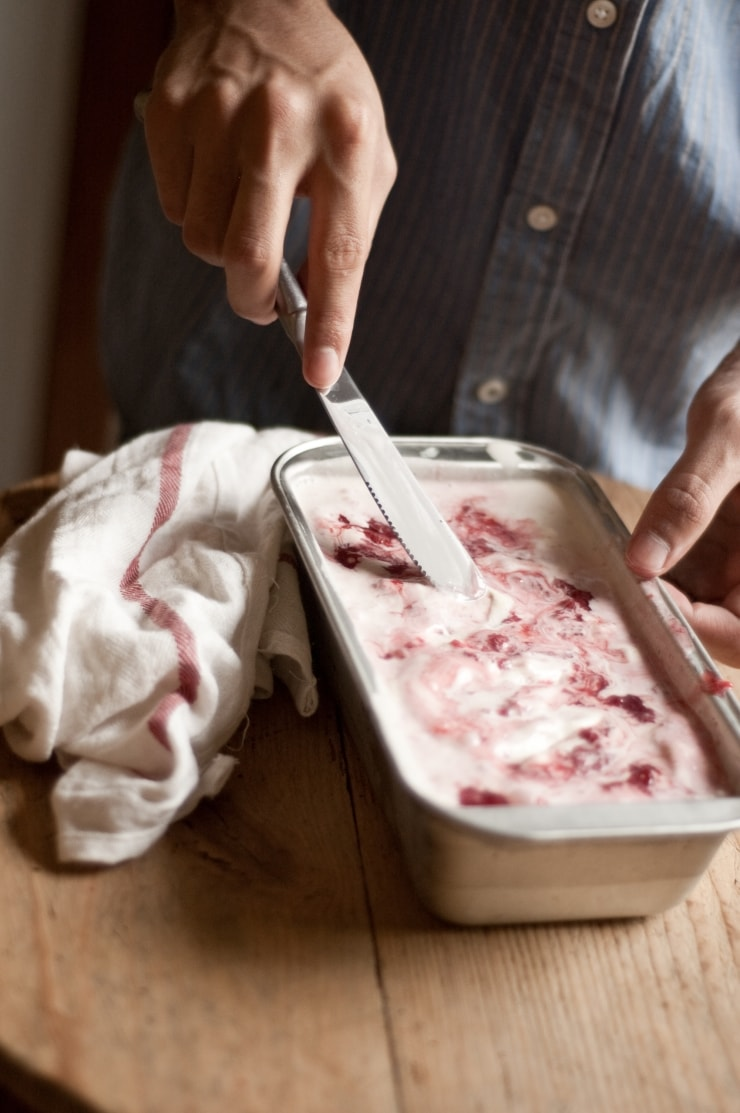 A delightful vanilla ice cream recipe swirled with homemade strawberry sauce. | sophisticatedgourmet.com