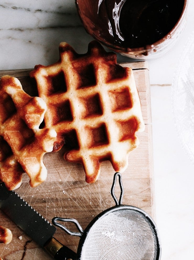 A Belgian waffle recipe for delicious, golden, and lighter-than-air belgian waffles. The best part? This easy waffle recipe only takes 5 mintues to prepare! | sophisticatedgourmet.com