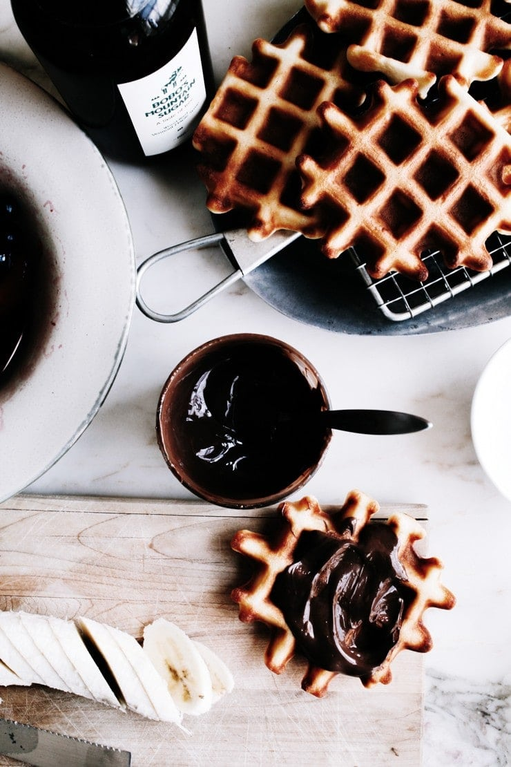 Crisp, golden, and sweet-smelling Belgian waffle recipe with a lighter-than-air center. So easy to make, they come together with just a few stirs! | sophisticatedgourmet.com