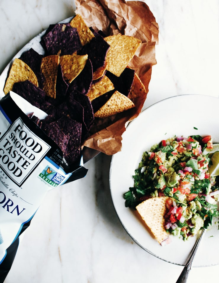 Guacamole is easy and comes together in no time. This guacamole recipe is no exception. It packs a lot of flavor and is perfect with chips and a drink. | sophisticatedgourmet.com