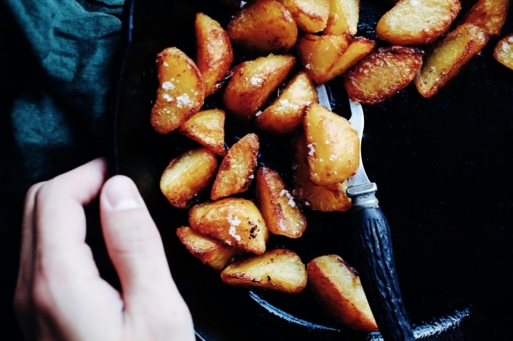 A recipe for the most easy crispy roasted potatoes you'll ever make. All you need is a few basic ingredients and a hot oven. | sophisticatedgourmet.com