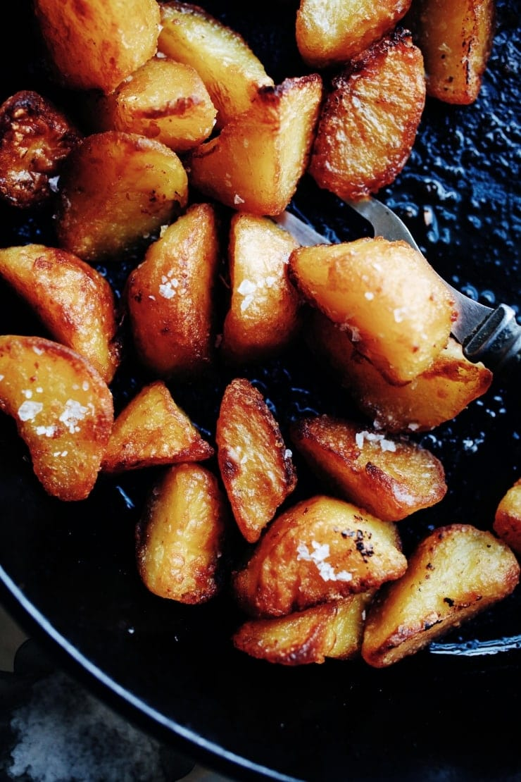 A recipe for the most fool-proof crispy roasted potatoes you'll ever make. All you need is a few basic ingredients and an oven. | sophisticatedgourmet.com