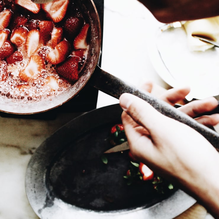 Strawberries cooking for jam