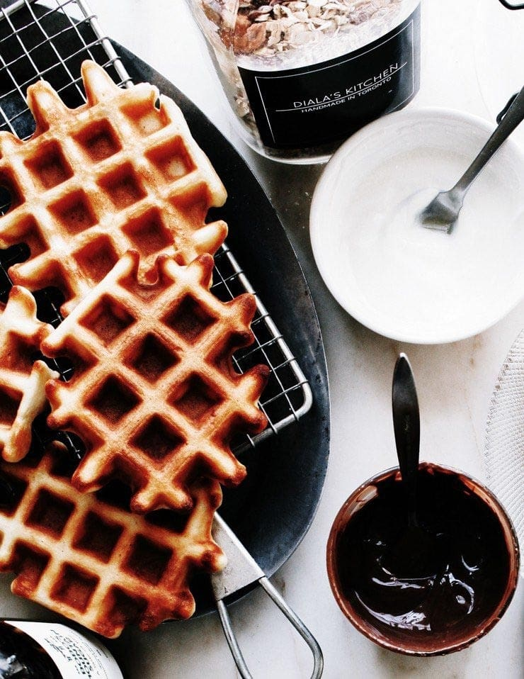Waffles with Nutella, yogurt, and granola on the side