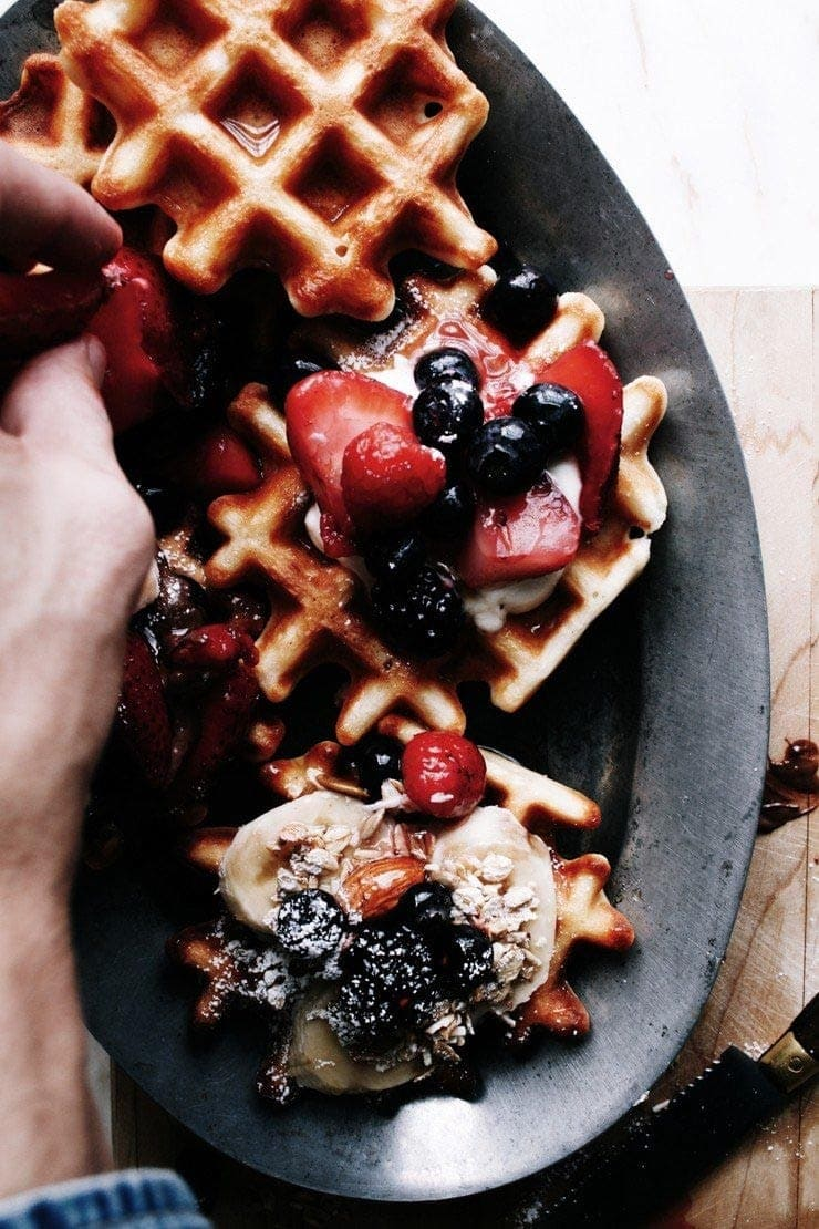 Homemade Easy Belgian waffles recipe with berries, granola, and yogurt from sophisticatedgourmet.com
