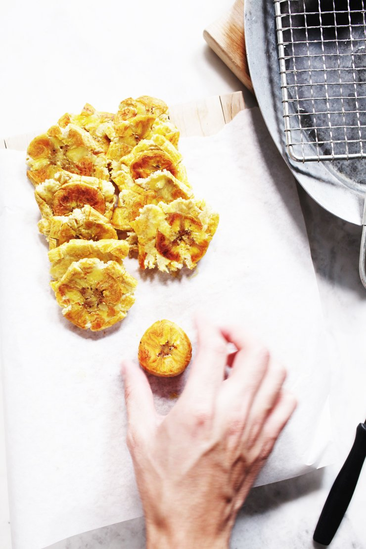 Smashing Plantains For Tostones